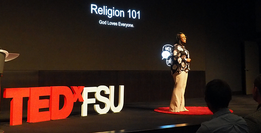 Kai Daniels on the TEDxFSU stage speaks about religion as member of the LGBTQ community.