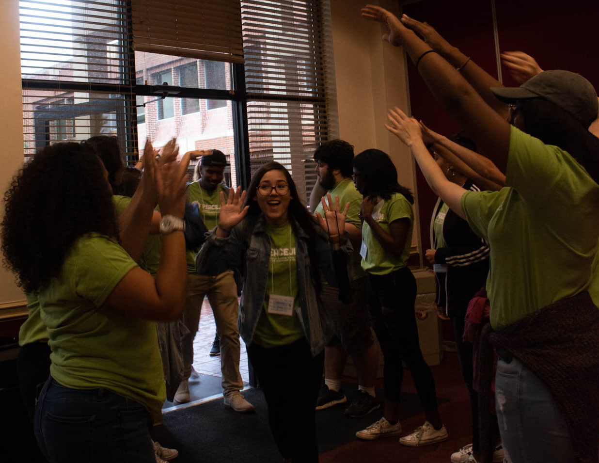 PeaceJam student attendees receive a warm and enthusiastic welcome from FSU student mentors for the 2018 PeaceJam Slam. Photo/ Courtney Carter