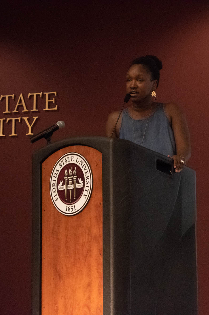 Keynote speaker Joviah Woodrich addresses attendees and mentors at the annual PeaceJam Slam.