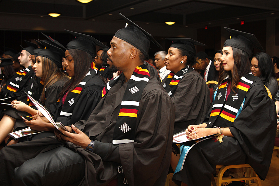 Graduating students attending a V-rak-ke-ce-tv cultural graduation ceremony