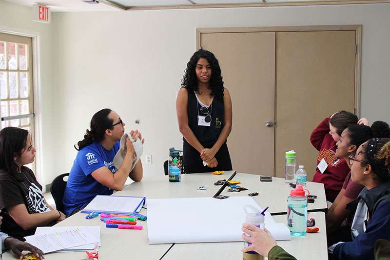 A LOGIC participant presenting during a group exercise.
