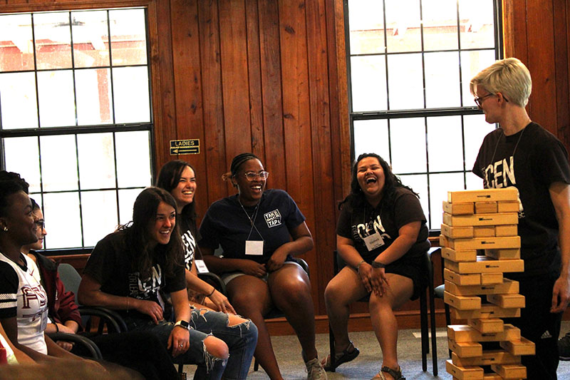 LOGIC participants laughing as a fun game is being prepared.