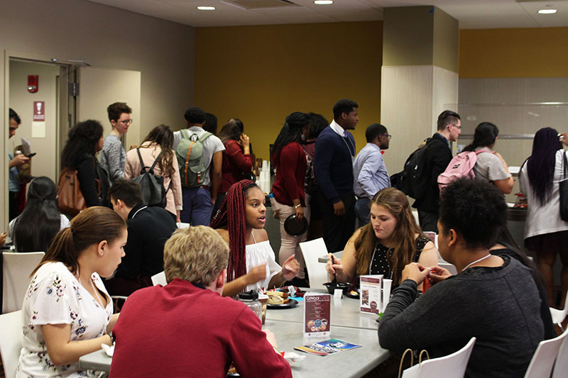 MLS participants socializing during lunch time